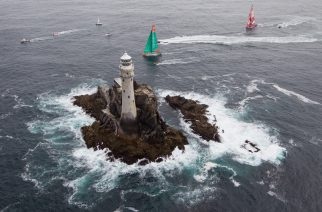 Groupama Sailing Team, skippered by Franck Cammas from France and CAMPER with Emirates Team New Zealand, skippered by Chris Nicholson from Australia, rounding Fastnet Rock, on leg 9 of the Volvo Ocean Race 2011-12, from Lorient, France to Galway, Ireland.